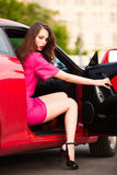 Stylish woman in red car Royalty Free Stock Images
