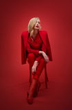 Stylish woman in red suit in studio Royalty Free Stock Photography
