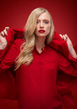 Stylish woman in red suit in studio Stock Photography