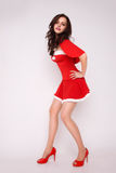 Stylish woman in red xmas costume Stock Photography