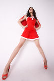 Stylish woman in red xmas costume Stock Photos