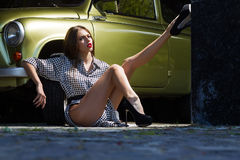 Stylish woman and retro car Stock Images