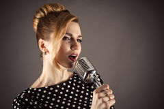 Stylish woman with a retro microphone Stock Photo