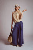 Stylish woman in retro suit with a bag Stock Photography