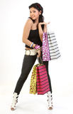 Stylish woman returning with shopping bags Royalty Free Stock Photos