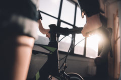 Stylish woman riding sports bicycle Royalty Free Stock Photo