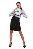 Stylish woman with a round clock in hands Stock Photo