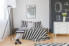 Stylish woman`s bedroom. With big bed and chalkboard wall Royalty Free Stock Photo