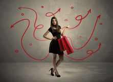 Stylish woman shopping and red arrows Royalty Free Stock Photo
