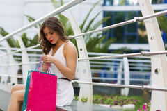 Stylish woman shopping in the summer city. Stylish woman with paper bags shopping in the summer city Royalty Free Stock Photography