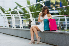 Stylish woman shopping in the summer city. Stylish woman with paper bags shopping in the summer city Stock Photo