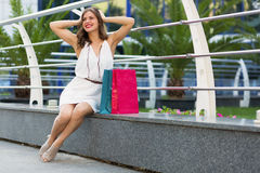 Stylish woman shopping in the summer city. Stylish woman with paper bags shopping in the summer city Stock Photos