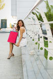 Stylish woman shopping in the summer city. Stylish woman with paper bags shopping in the summer city Stock Photography