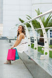 Stylish woman shopping in the summer city. Stylish woman with paper bags shopping in the summer city Royalty Free Stock Photo