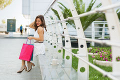 Stylish woman shopping in the summer city. Stylish woman with paper bags shopping in the summer city Stock Images
