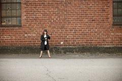 Stylish woman with shotgun Royalty Free Stock Photos