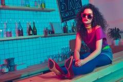 stylish woman sitting on counter stock photo