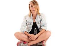Stylish woman sitting on the floor Stock Photography