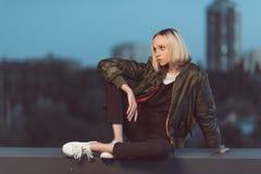 Stylish woman sitting outdoors Stock Image