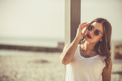 Stylish woman at the summer beach in a hot day Stock Photo