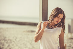 Stylish woman at the summer beach in a hot day Stock Images