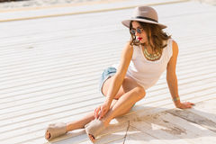 Stylish woman at the summer beach in a hot day Royalty Free Stock Photos