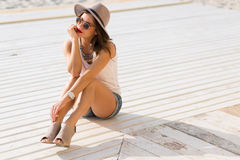 Stylish woman at the summer beach in a hot day Royalty Free Stock Image