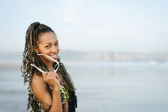 Stylish woman on summer vacation at the beach Royalty Free Stock Image