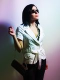 Stylish woman with sunglasses and purse Royalty Free Stock Photography
