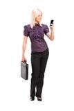 Stylish woman talking on a phone Stock Photography