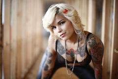 Stylish woman with tattoos royalty free stock photography