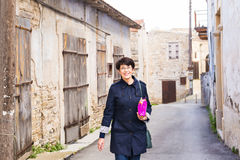 Stylish woman walking around old town. Female outdoors Royalty Free Stock Photos