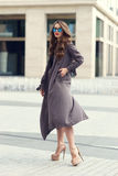 Stylish woman walking in the city Stock Photography