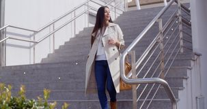 Stylish woman walking down a flight of stairs