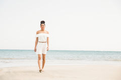 Stylish woman walking on the sand Stock Photos