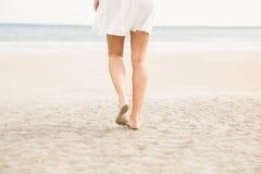 Stylish woman walking on the sand Stock Photo