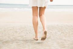 Stylish woman walking on the sand Stock Image