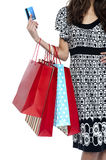 Stylish woman walking with shopping bags and credit card Stock Photos