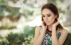 Stylish Woman Wearing Floral Dress and Big Necklace Royalty Free Stock Images