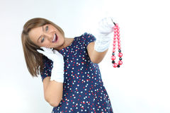 Stylish woman wearing polka dots dress and feeling good and dancing in the studio Stock Photography