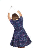 Stylish woman wearing polka dots dress and feeling good and dancing in the studio Stock Image