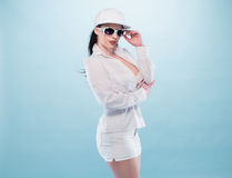 Stylish Woman in White Dress with Glasses and Cap Royalty Free Stock Photography