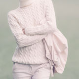 Stylish woman in white glamorous clothes. Fall Winter fashion st