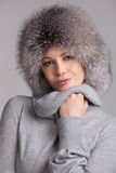 Stylish woman in winter fur hat Royalty Free Stock Photos