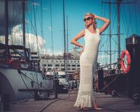 Stylish woman on a wooden pier stock photos