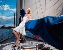 Stylish woman on a yacht stock photo