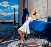 Stylish woman on a yacht. Stylish wealthy woman on a luxury yacht Stock Photos