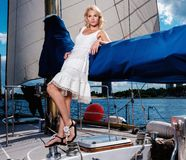 Stylish woman on a yacht Royalty Free Stock Images