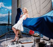 Stylish woman on a yacht Stock Images