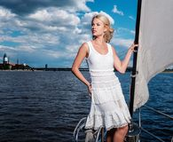 Stylish woman on a yacht Stock Photos